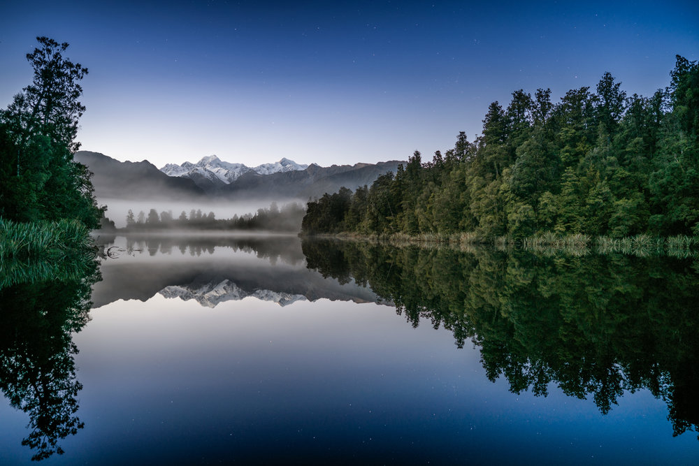 Lake Matheson under the stars - 25mm @ F2, multiple exposure blend